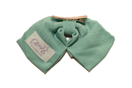 Back view of dusty aqua green hair bow with alligator clip.