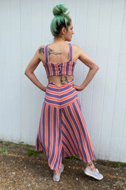 Back view cut out of retro style purple and coral chevron striped 1930s inspired beach pajamas.