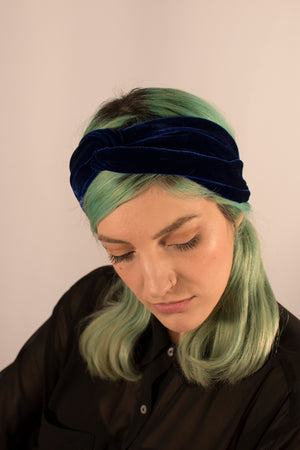 Navy velvet twist front headband on model.