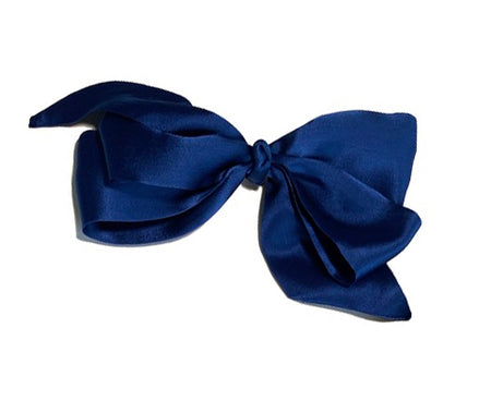 Luxurious navy blue silk charmeuse clip on hair bow.