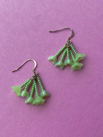 Fun green beaded drop earrings with flowers.