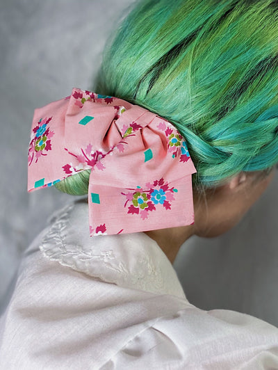 Pink cotton with turquoise diamonds and floral bouquets print 1940s lolita hair bow.