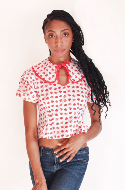 Sweet red and white Art Deco print cotton puff sleeve blouse with Peter Pan collar and keyhole neckline.