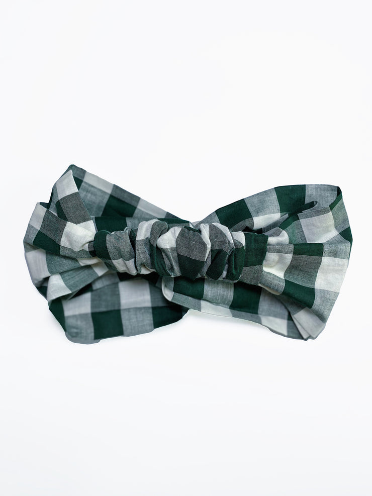 Back view of retro style twist front forest green gingham headband with ruched back.