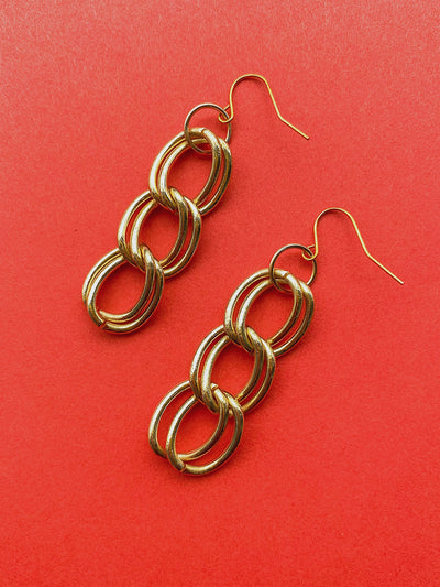 Gold chain link dangle earrings.