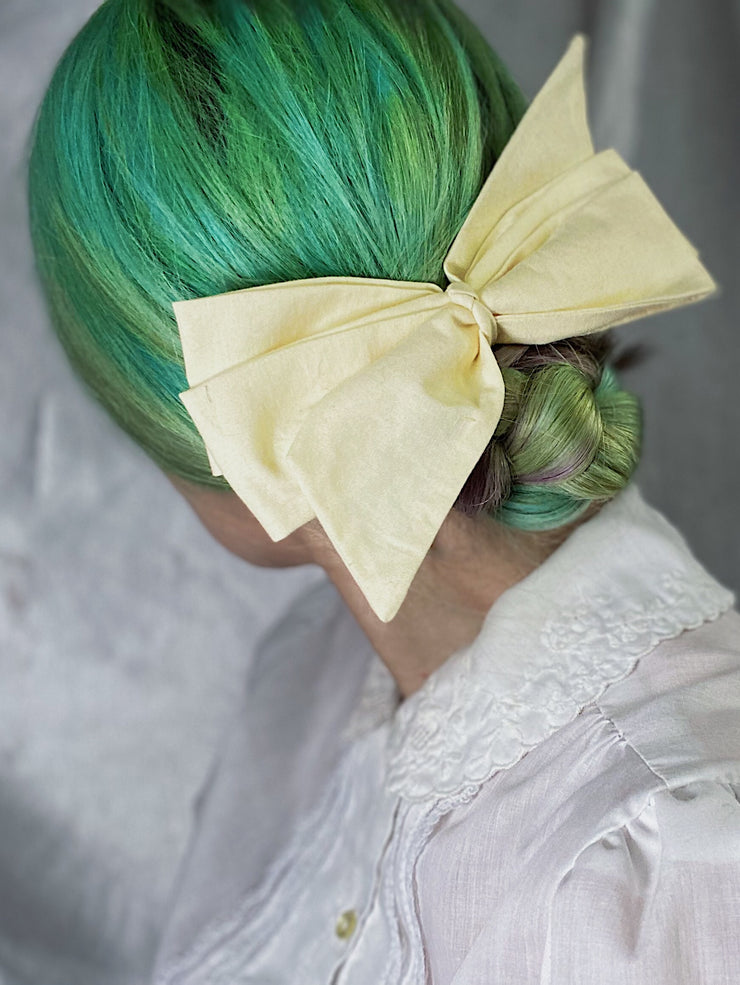 pastel yellow clip in hair bow lemon yellow retro style