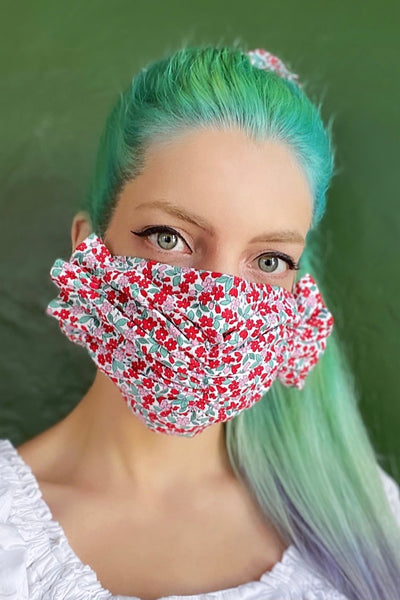Cute red and pink floral feed sack cotton print ruffled face mask.