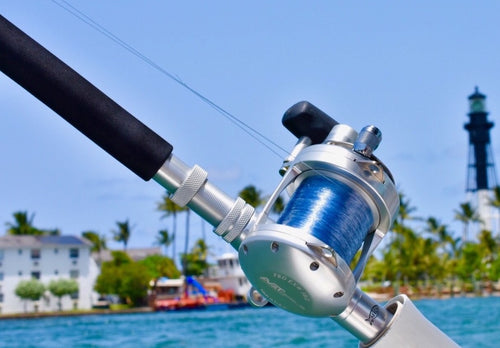 avet exw 30/2 big game reel on custom rod in front of lighthouse