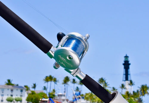 avet 6.0 reel on custom rod in front of lighthouse point lighthouse