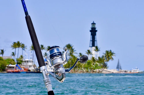 Shimano Saragosa 8000 sw spinning reel on custom rod in front of light house
