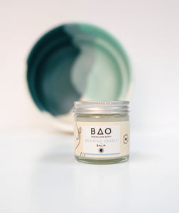BAO nourish balm with plate in the background