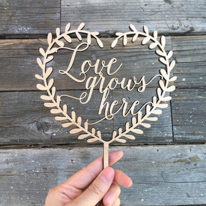 "Love Grows Here Heart Wreath Cake Topper, 5.5""W"