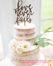 "Load image into Gallery viewer, Love Never Fails Cake Topper, 5""W"
