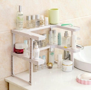the adjustable spice rack being used in a bathroom for soaps and perfumes