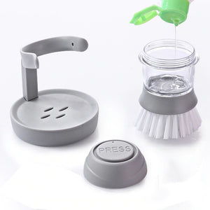 the Automatic Cleaning Liquid Dispenser Brush separated into its three different parts, the container section is being filled with soap on a white background