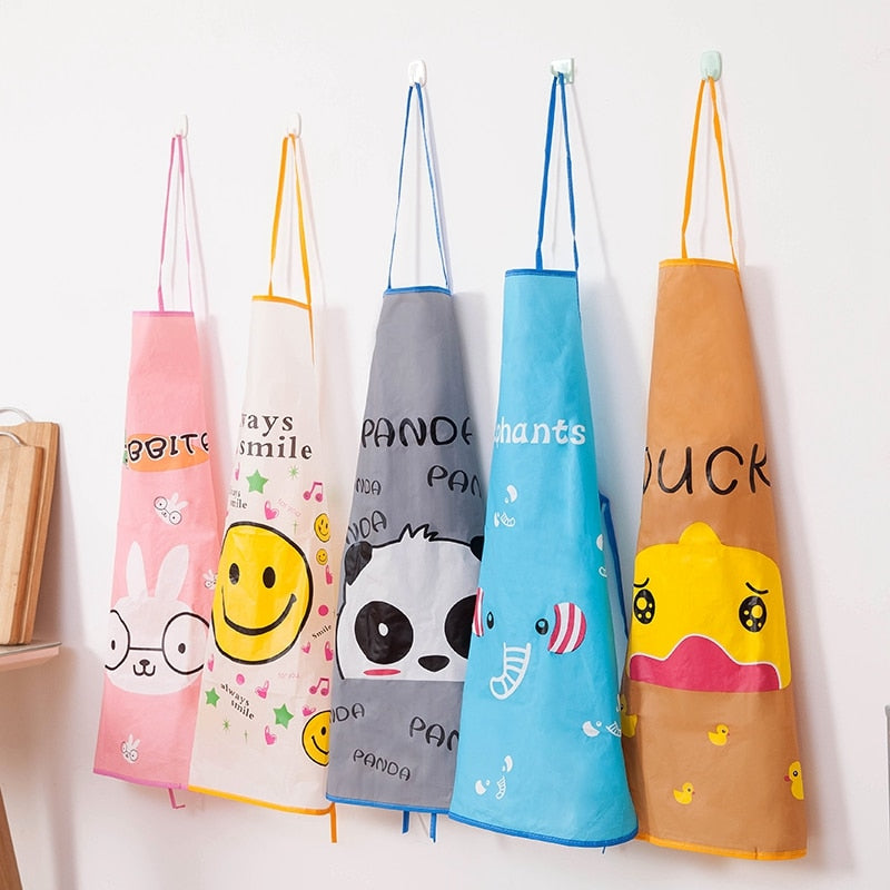rabbit, smile, panada, elephant and duck kitchen aprons hanging from wall