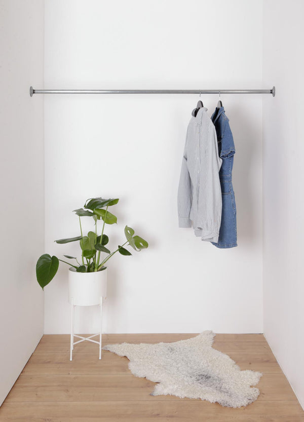 RAW58 Marzello wall-mounted clothing rail between two walls in silver