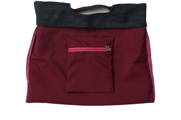 Warm, inviting red wine dark red with pink zipper. Reversible upcycled cotton ladies eco bag with zipper pocket. Sustainable, ethical on the go essentials for beach or city. Empowers women in Brazilian slums.