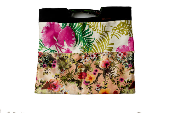 Vibrant green pink and silky orange flowers. Reversible upcycled cotton ladies eco bag with zipper pocket. Sustainable, ethical on the go essentials for beach or city. Empowers women in Brazilian slums.