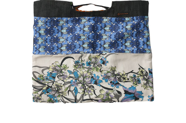 Dual patterns of blue and zen flowers. Reversible upcycled cotton ladies eco bag with zipper pocket. Sustainable, ethical on the go essentials for beach or city. Empowers women in Brazilian slums.