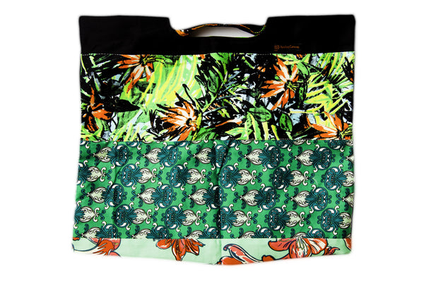Vibrant green and orange flowers with green and black pattern. Reversible upcycled cotton ladies eco bag with zipper pocket. Sustainable, ethical on the go essentials for beach or city. Empowers women in Brazilian slums.