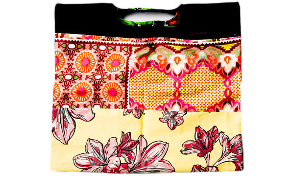 Bright yellow and pink tea party motif. Reversible upcycled cotton ladies eco bag with zipper pocket. Sustainable, ethical on the go essentials for beach or city. Empowers women in Brazilian slums.