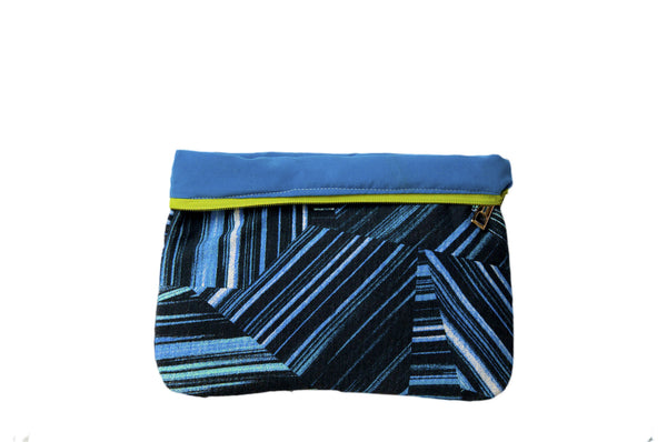 Upcycled handmade cotton ipad bag with zipper closure. Features neon blue geometrical lines on black background. Neon blue lining shown. Sustainable, fair trade, ethically produced. Empowers women in Brazilian favela slums in Rio de Janeiro.