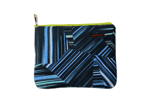 Upcycled handmade cotton ipad bag with zipper closure. Features neon blue geometrical lines on black background. Sustainable, fair trade, ethically produced. Empowers women in Brazilian favela slums in Rio de Janeiro.