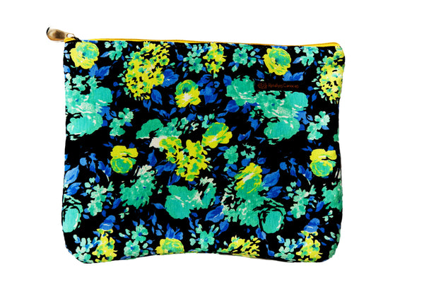 Upcycled handmade cotton ipad bag with zipper closure. Features blue, green and yellow floral scene. Sustainable, fair trade, ethically produced. Empowers women in Brazilian favela slums in Rio de Janeiro.