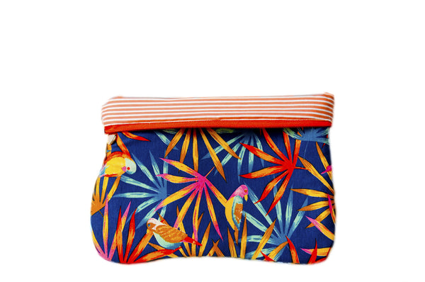Upcycled handmade cotton ipad bag with zipper closure. Features vibrant amazonian flowers and birds with orange lining. Sustainable, fair trade, ethically produced. Empowers women in Brazilian favela slums in Rio de Janeiro.
