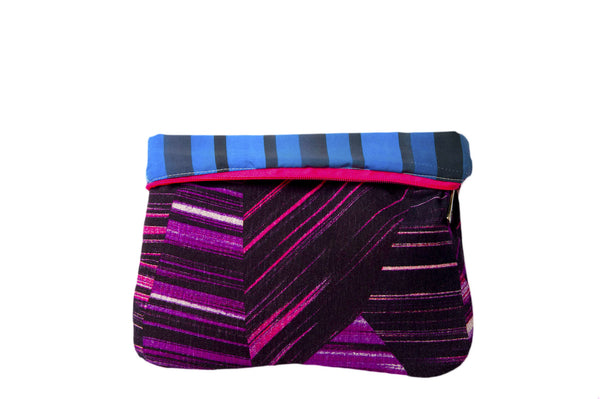 Upcycled handmade cotton ipad bag with zipper closure. Features neon pink geometrical lines on black background. Neon blue striped lining shown. Sustainable, fair trade, ethically produced. Empowers women in Brazilian favela slums in Rio de Janeiro.