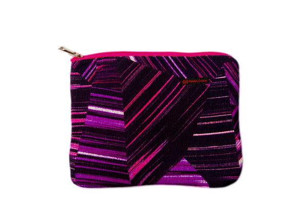 Upcycled handmade cotton ipad bag with zipper closure. Features neon pink geometrical lines on black background. Sustainable, fair trade, ethically produced. Empowers women in Brazilian favela slums in Rio de Janeiro.