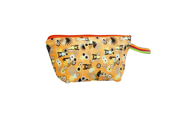 Spastic orange kidrobot monkeybot universe. Upcycled handmade cotton clutch bag with zipper closure. Sustainable, fair trade, ethically produced. Empowers women in Brazilian favela slums in Rio de Janeiro.