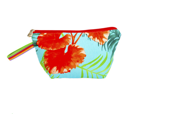 Vibrant red and green lilly pads over light blue background. Upcycled handmade cotton clutch bag with zipper closure. Sustainable, fair trade, ethically produced. Empowers women in Brazilian favela slums in Rio de Janeiro.