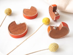 Wooden earrings with orange leather