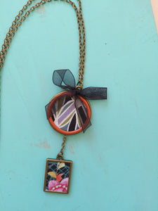 Bronze base necklace made with fabrics.