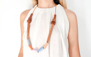 Woman with Etnia necklace in pastel tones