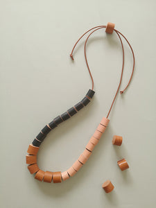 Necklace made with leather rolls from the authentic kit
