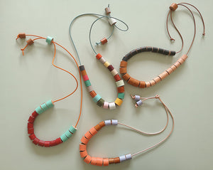Necklaces made with leather rolls from the authentic kit