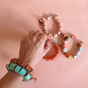 Hand with tuquitos bracelets