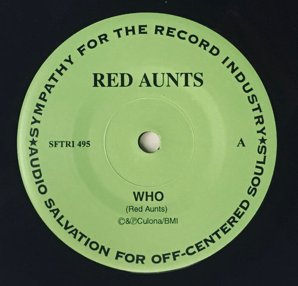 "Red Aunts, ""Who,"" b/w Constant Comment, ""Fire Crasher"" Split Single (1997). A-side record label sticker image. Punk, pop-punk."