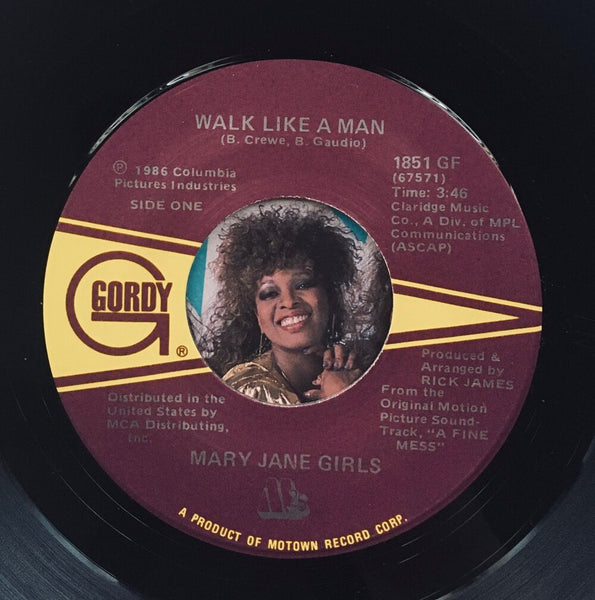 "Mary Jane Girls, ""Walk Like A Man"" Single (1986). Record label sticker image. Pop, funk, and soul. From the 80s movie soundtrack, ""A Fine Mess."""