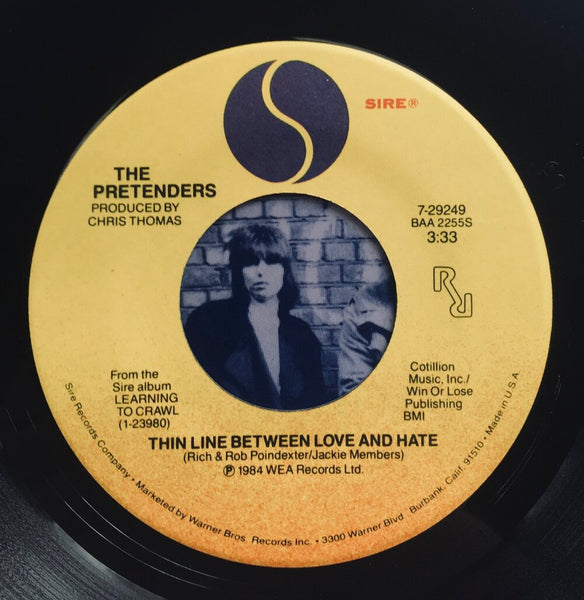 "The Pretenders, ""The Line Between Love and Hate"" Single (1984). Record label sticker image. Power-pop, pop-punk, punk."
