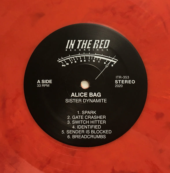 "Alice Bag, ""Sister Dynamite"" LP (2020) red marble vinyl and label image. In The Red Records. Punk rock."