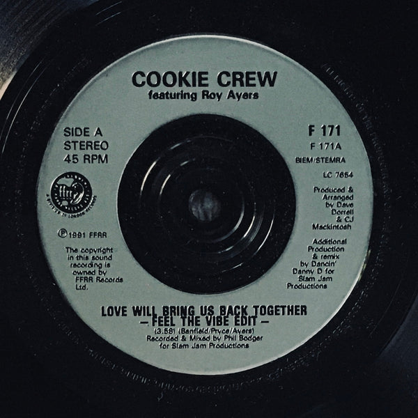 "Cookie Crew, ""Love Will Bring Us Back Together"" Single (1991). Silver-injection label sticker image. Hip-hop and rap duo from Clapham, London (UK), import remix and edits. Features Roy Ayers."