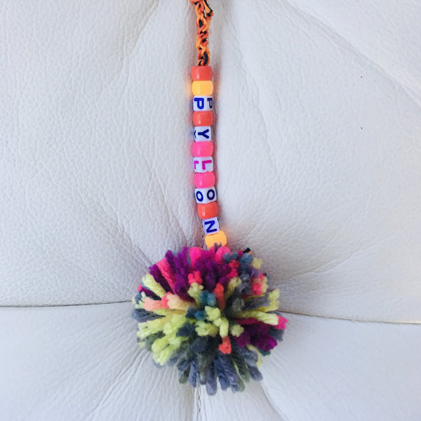 "Braided Bag Pom-Pom Pull ""Pylon"" Variation #1"