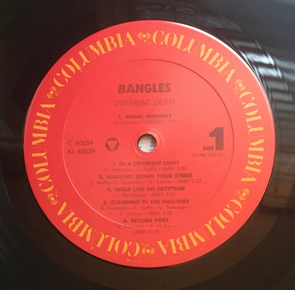 "The Bangles, ""Different Light"" LP (1985). Record label sticker image. Pop-rock, power-pop."