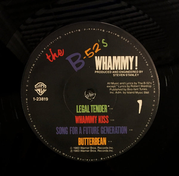 "The B-52's, ""Whammy!"" LP (1983). Record label sticker image. Pop, experimental, pop-rock, alternative rock."
