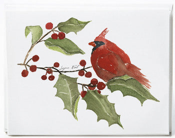a holiday card with a red cardinal on a holly branch