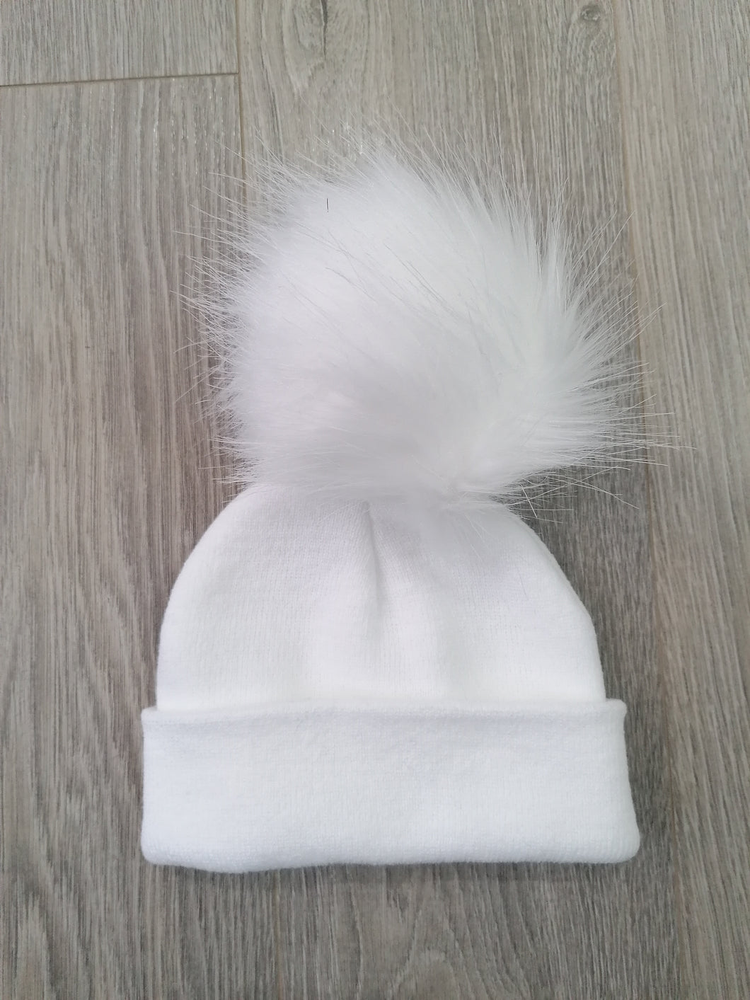 White Hat with One Large Pom